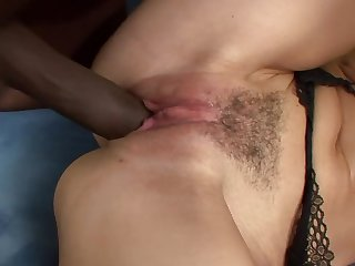 A milf with a nice round ass is getting a black dick inside her